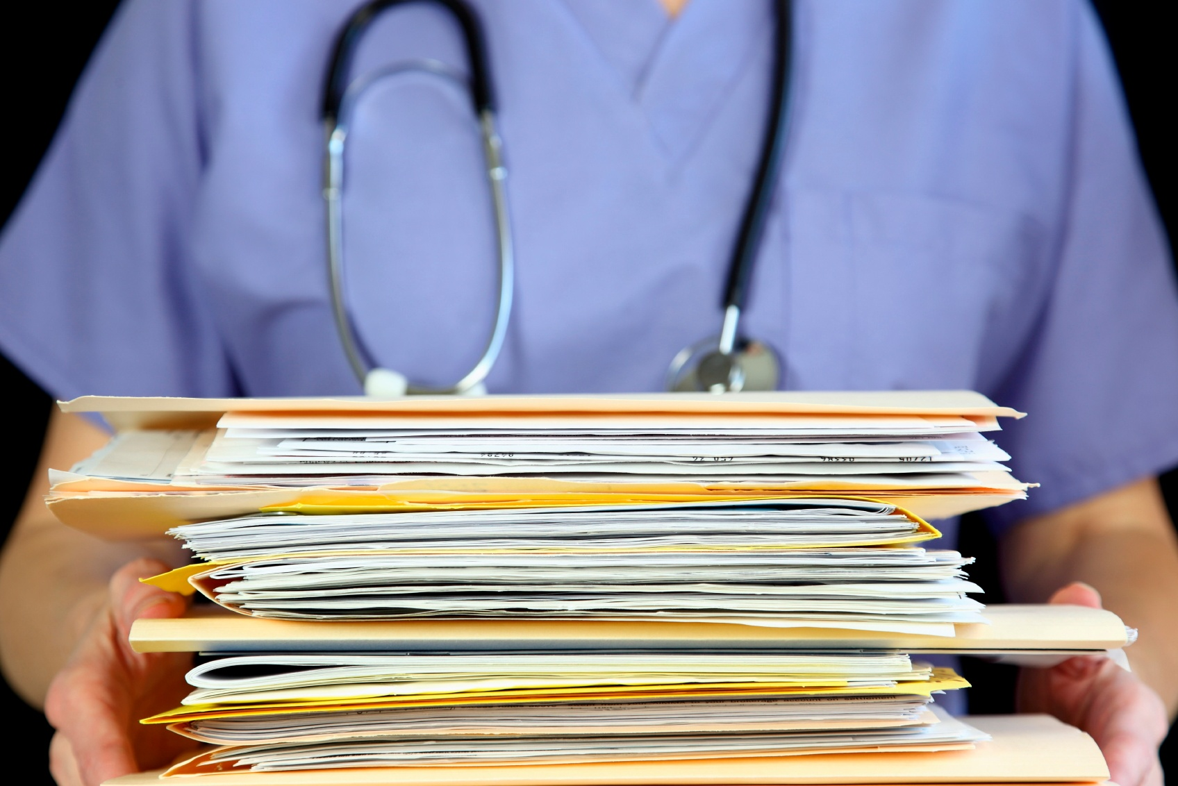 nurse-holding-medical-files.jpg